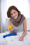 Woman holding lemon on the bed Royalty Free Stock Photography