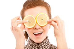 Woman holding lemon near her eyes Royalty Free Stock Photo