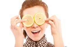 Woman holding lemon near her eyes Royalty Free Stock Photo