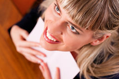 Woman is holding a letter Royalty Free Stock Images