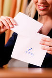Woman is holding a letter Royalty Free Stock Photos