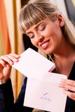 Woman is holding a letter Stock Images
