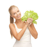 Woman holding lettuce Stock Photography