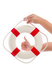 Woman holding lifebuoy - concept for security Royalty Free Stock Photos