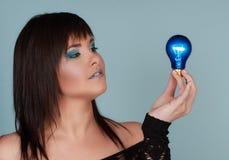 Woman holding light bulb stock photo