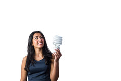 Woman holding a light bulb in her hand. Against a white background Stock Photos