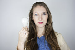 Woman holding light bulb Stock Photos