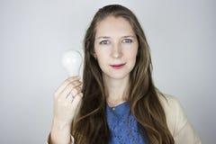 Woman holding light bulb Stock Photos