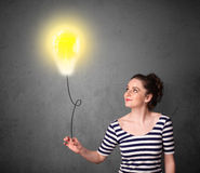 Woman holding a lightbulb balloon Stock Images
