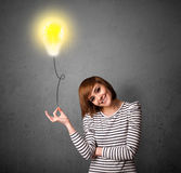 Woman holding a lightbulb balloon Royalty Free Stock Photos