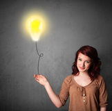 Woman holding a lightbulb balloon Royalty Free Stock Photo