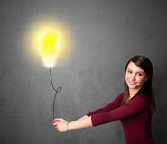 Woman holding a lightbulb balloon Stock Photo