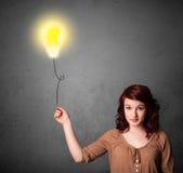 Woman holding a lightbulb balloon Royalty Free Stock Photo