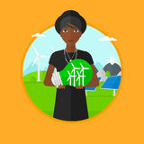 Woman holding lightbulb with wind turbines inside. Royalty Free Stock Photography