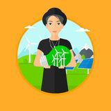 Woman holding lightbulb with wind turbines inside. Royalty Free Stock Image