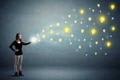 Woman holding lightbulbs Royalty Free Stock Photo