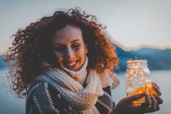 Woman Holding Lighted Jar Smiling Royalty Free Stock Images