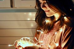 Woman Holding Lighted String Light Royalty Free Stock Images