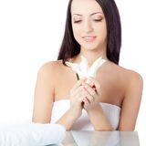 Woman holding lily flower over white Stock Image