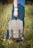 Woman holding linen backpack bag. Template mock up Royalty Free Stock Photos