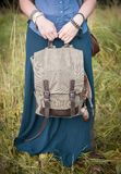 Woman holding linen backpack bag. Template mock up Royalty Free Stock Photo
