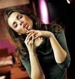 Woman holding a lipstick Stock Photo