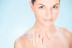 Woman holding lipstick Stock Photography