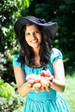 Woman holding litchis Royalty Free Stock Image