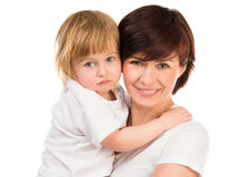 Woman holding a little blond baby. Young dark-haired women holding a little blond baby on hands on a white background Stock Photography