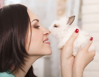 Woman holding little cute rabbit, close up Stock Photos