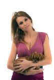 woman holding little dog on Stock Photos
