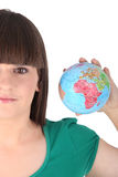 Woman holding a little globe Royalty Free Stock Photo