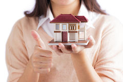 Woman holding little house Royalty Free Stock Photography