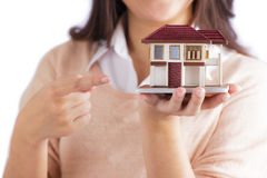 Woman holding little house Stock Photo