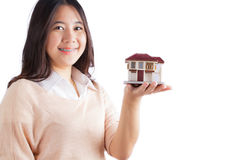 Woman holding little house Royalty Free Stock Photos
