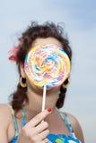 Woman holding a lollipop Stock Photos
