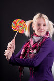 Woman holding lollypop. Young blond woman holding lollypop Royalty Free Stock Photo