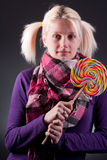 Woman holding lollypop. Young blond woman holding lollypop Stock Images
