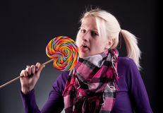Woman holding lollypop. Young blond woman holding lollypop Stock Image