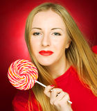 woman holding lollypop Royalty Free Stock Photos