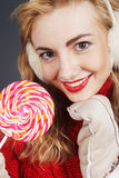 Woman holding lollypop. Pretty young blond woman holding lollypop Royalty Free Stock Image