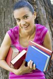Woman holding a lot of books Stock Photo