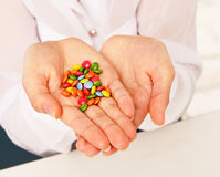 Woman holding lot of candy Stock Photo