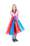 Woman holding lot of present paper bags acting joyful Royalty Free Stock Photography