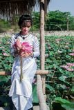 Woman holding lotus flowers Stock Photography