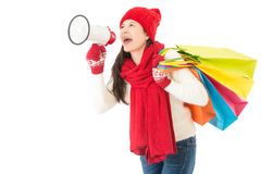 Woman holding loud megaphone call for winter sale. Beautiful asian woman holding loud megaphone call for winter sale with colorful shopping bag. isolated on Royalty Free Stock Photo