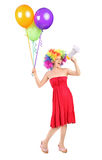 Woman holding a loudspeaker and balloons Royalty Free Stock Photography