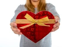 Woman holding a love heart box on white background Royalty Free Stock Photos
