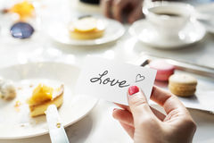 Woman holding love note on small card Stock Photo