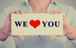 Woman holding we love you sign Royalty Free Stock Photography